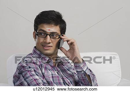 60091fa229 South Indian man talking on a mobile phone Stock Photography ...