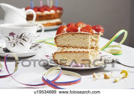 Slice Of Birthday Cake With Tea