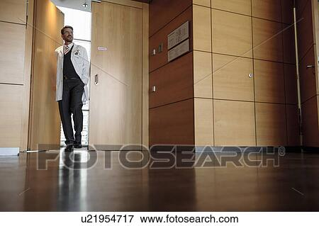 Office hallway Curved Doctor Walking In Office Hallway Fotosearch Picture Of Doctor Walking In Office Hallway U21954717 Search Stock