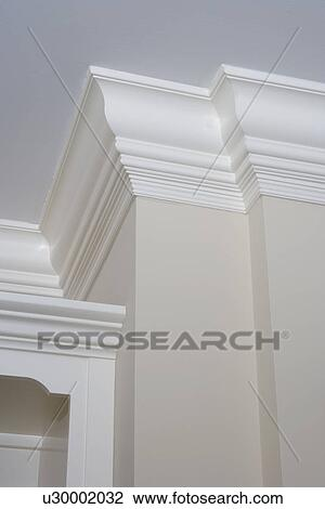 Stock Image Architectural Trim Detail Of White Painted Crown Molding Partial Built In