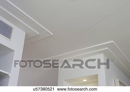 ARCHITECTURAL TRIM: plaster crown molding surrounding built in display  shelves, simple minimal lines, Stock Image
