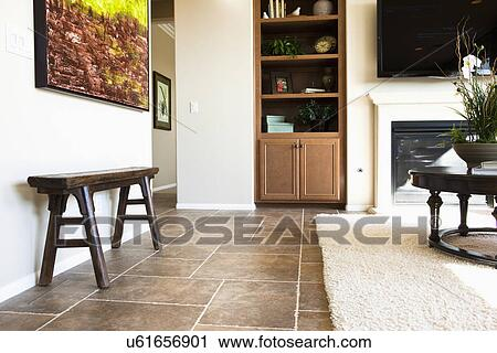 Stock Photography of Area rug on tile floor in living room, Tustin ...