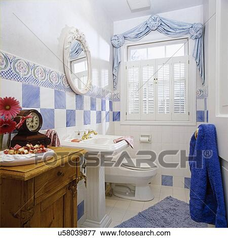 White Bathroom With Powder Blue Accents