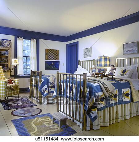 BEDROOMS: children\'s room, country style, matching quilts on twin beds,  yellow and blue color theme, brass beds, painted wide plank wood floors, ...
