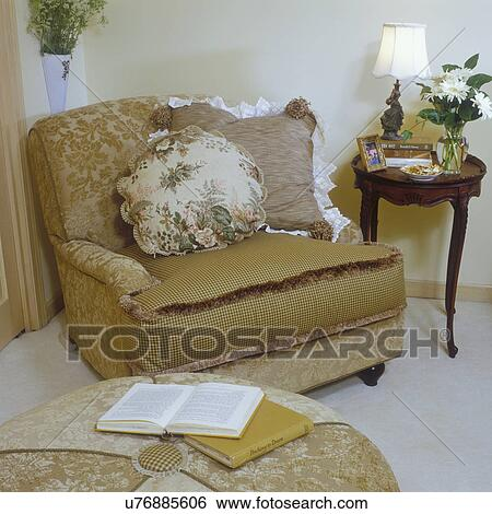 Bedrooms Sitting Area In Bedroom Large Over Stuffed Chair With Mixed Patterns Beige To Brown Colors Side Table Books And Lamp