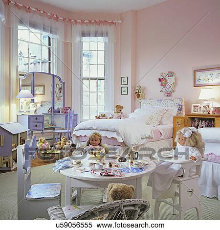 CHILDREN\'S BEDROOM: Girl\'s bedroom. Dolls and bears and a tea table.  Dollhouse, pale pink walls, sheer valances tied to rod with pink ribbons,  purple ...