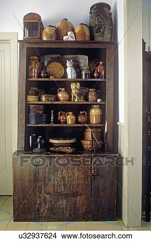 COLLECTION DISPLAYS: Primitive Dark Cabinet Holds Collection Of Brown Ware  Pottery And Early American Wooden Boxes, Slipware, Figural Pottery