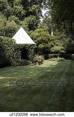 Conical Shade With Trees And Potted Plants In Lawn