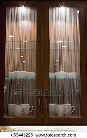 Contemporary glass kitchen cabinets; Corona Del Mar; California; USA