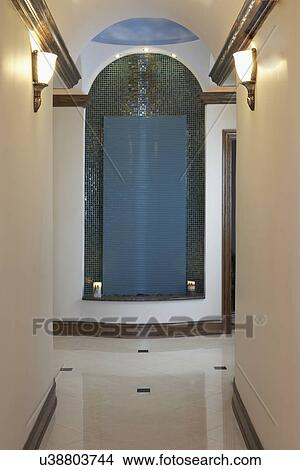 DAY SPA: Hallway with tile waterfall near entrance, clouds painted on  ceiling, crown molding, marble tile floors Picture