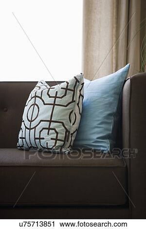 Amazing Detail Blue Throw Pillows On Chocolate Brown Sofa; Oxnard; California; USA