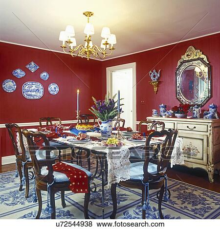 DINING ROOMS Red Walls Eclectic Mix White Painted Trim And Chair Rail Brass Chandelier Blue Cream Patterned Area Rug Plate Display On Wall