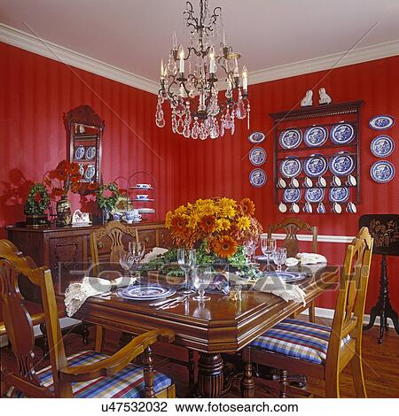 Stock Photo Of DINING ROOMS: Traditional Dining Room With Red Striped  Walls, White Crown Molding And Chair Rail, Blue And White Plate Collection  Displayed ...