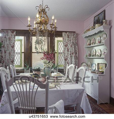 DINING ROOMS - Vintage curtains, shabby chic, cottage look, light pink  walls, white chairs, and tablecloth, chandelier, salvaged Tudor style  windows ...