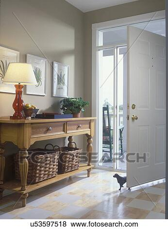 ENTRY HALL Transom And Sidelight Windows In Front Door Entry Painted Checkerboard Wood Floor Hall Table With Botanical Prints Storage Baskets