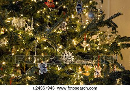 Extreme Close Up Of Lit Christmas Tree With Decoration Ornaments