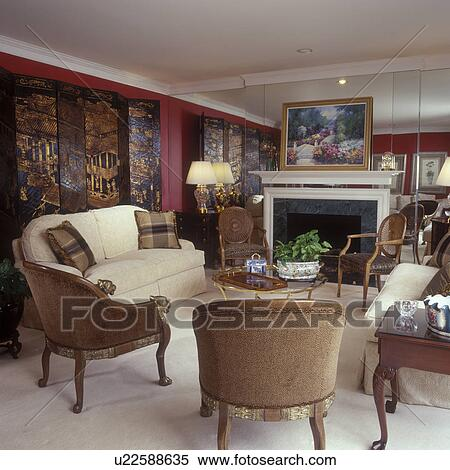 FIREPLACE - formal living room  Mirrored wall, molding, crown molding, red  walls, Asian folding screen, animal print chairs, ivory loveseat, fireplace