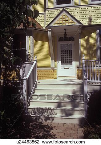 Front Doors Exterior Of Front Entrance White Trim And Wooden Steps To Deck Architectural Details And Various Trim Work Remodeled Victorian 2 Shades Of Yellow Stock Image U24463862 Fotosearch