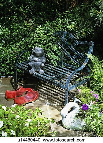 Stock Photography Of Garden Bench In Corner Of Patio Frog Statue