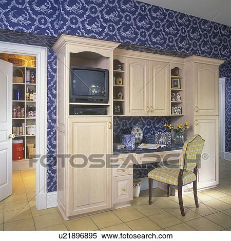 Stock Image Of KITCHEN DESK AREA: Built In Desk Area, With Cabinets,  Shelving, And TV. Tan Ceramic Tile Floor. Dark Blue And White Botanical  Patterned Wall ...