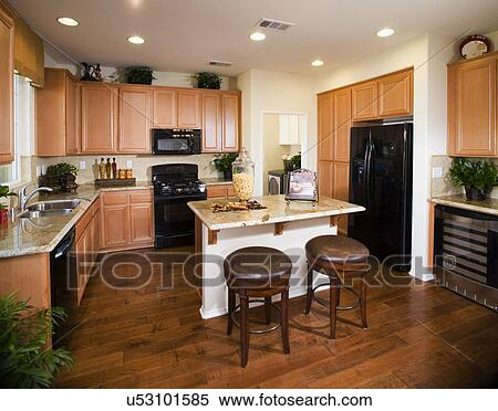 Kitchen island with breakfast bar in kitchen; Rancho Cucamonga; California;  USA Stock Photography