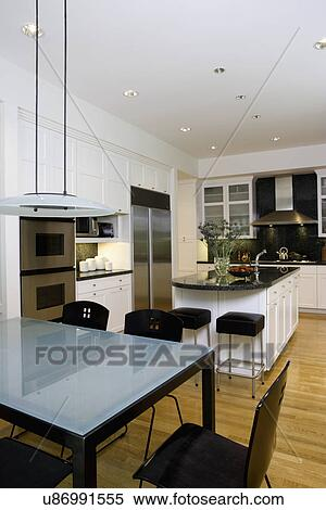 KITCHENS: frosted glass table top of eating area, pendant light, kitchen  island, stainless steel appliances, granite counters and backsplash, double  ...