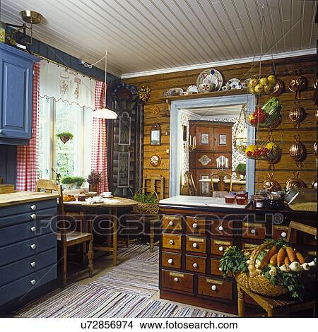 KITCHENS: Scandinavian kitchen with blue cabinets and one antique cabinet. & Stock Photo of KITCHENS: Scandinavian kitchen with blue cabinets and ...