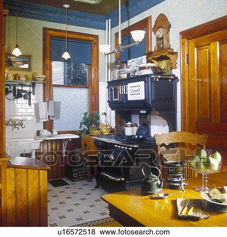 Kitchens View To Restored 1916 Glenwood Cast Iron Stove In Remodeled Victorian Kitchen Green Tin Molding Lots Of Authentic Antiques And Accessories William Morris Style Wallpaper Pressed Back Chair Penny