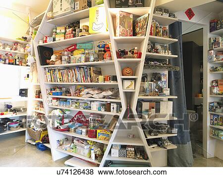 Knick Knacks And Groceries On Floor To Ceiling Shelves