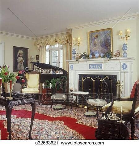 LIVING ROOMS - Formal living room, Louis XV style chairs, grand piano,  antiques, white fireplace mantel with Wedgewood insets, Oriental rug,  yellow ...