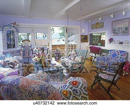 LIVING ROOMS   Lilac Walls, White Trim, Bright And Cheery, Lots Of Fabric  Mix, Cottage Style, Wood Porch Swing, Over Stuffed Chairs And Sofa, Wood  Floor.