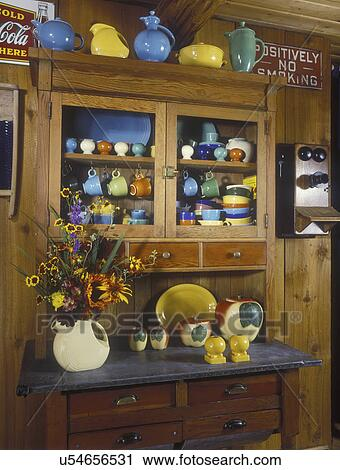 RUSTIC CABINS: Kitchen, detail of vintage baking cabinet, salvaged from  layers of paint, filled with colorful vintage items, Fiesta ware, apple ...