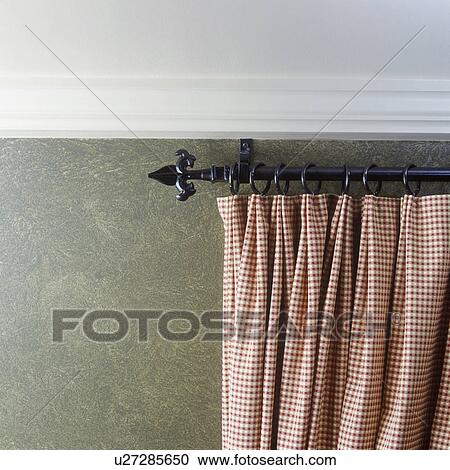 Window Treatment Detail Of Checkered Drape On Wrought Iron Rod Faux Painted Wall Stock Image