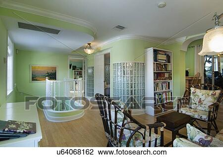 Sitting Area With Bookshelf And Glass Block Wall Along Stairs West Palm Beach USA