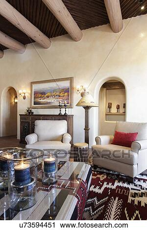 Living Room With Seating Furniture And Ceiling With Wooden Beams; Santa Fe; New  Mexico; USA