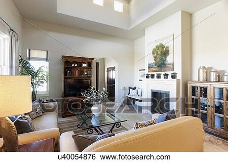 Living Room With Seating Furniture; Fireplace And Shelf At Home; Santa Fe; New  Mexico; USA