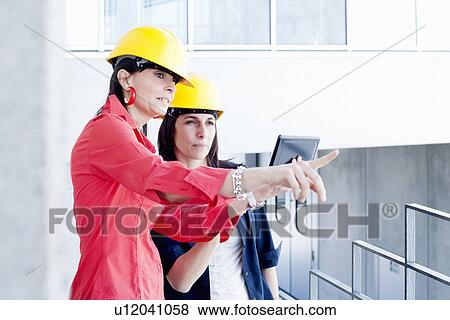 ec739186523 Pictures of Businesswomen in safety helmet taking photograph ...