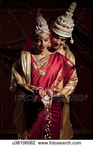 Stock Photo Of Bengali Bride And Groom Making An Offering U38106082