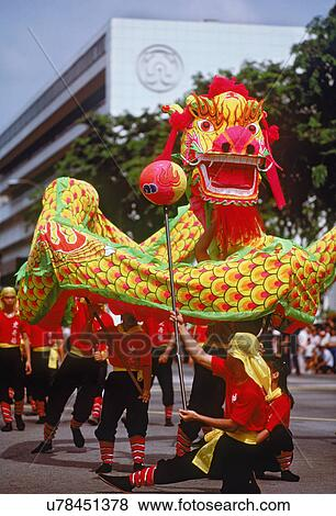 dragon dance on streets of singapore during chinese new year