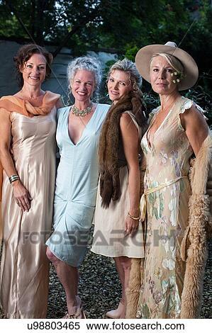 Portrait Of Elegant Mature Women In Urban Garden Stock