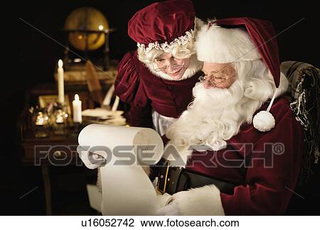 Santa And Mrs Claus Reading Childs Letter