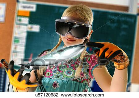a459fb0104fc Girl pretending to be teacher wearing virtual reality headset and gloves to  show whale