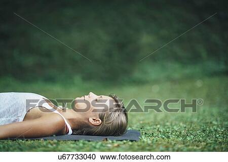 yoga corpse pose stock image  u67733040  fotosearch