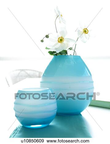 Stock Photograph Of Japanese Anemone In Light Blue Glass Vases