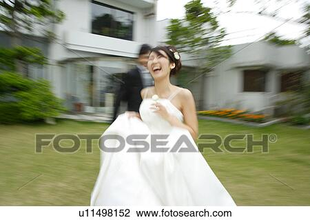 Fine Bride And Groom Running On Lawn Blurred Motion Stock Image Download Free Architecture Designs Scobabritishbridgeorg