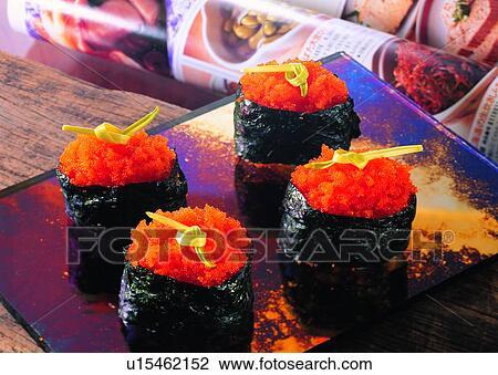 Food, sushi, fish eggs, plate, book, gunny Stock Image