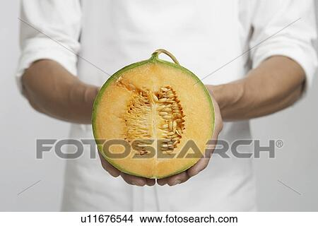 Chef Holding Half Of Cantaloupe Melon Mid Section Picture U11676544 Fotosearch This feature requires flash player to be installed in your browser. fotosearch