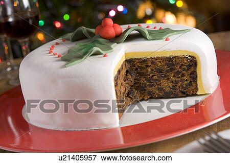 decorated christmas fruit cake with slices taken - Christmas Fruit Cake Decoration