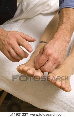 Acupuncture on Foot Stock Photo | u11921237 | Fotosearch