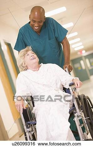 Stock Images of An Orderly Pushing A Senior Woman In A Wheelchair ...